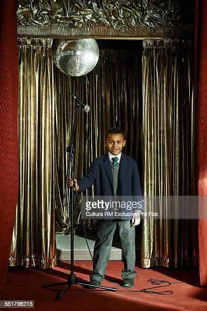 Boy preparing to sing on stage