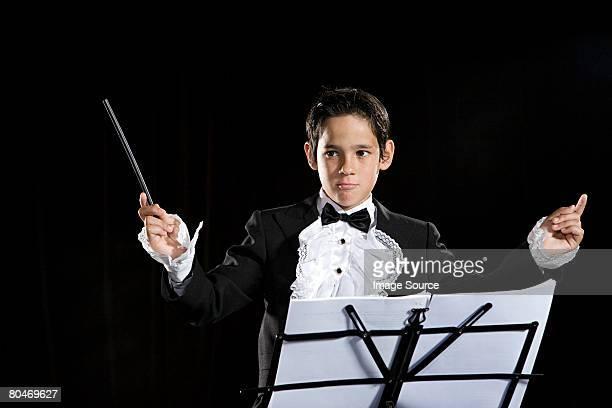 a boy pretending to be a composer - 指揮者 ストックフォトと画像