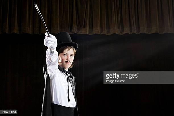 A boy pretending to be a magician