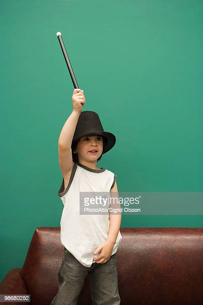 Boy pretending to be magician