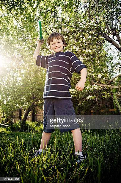 Boy pretending to be super hero