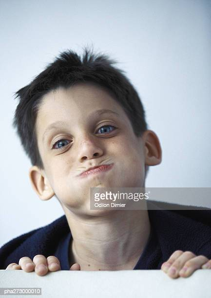 Boy puffing out cheeks, portrait