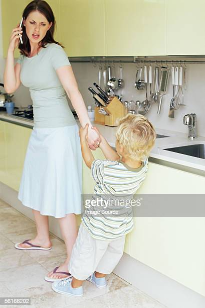 Boy pulling on mother's arm