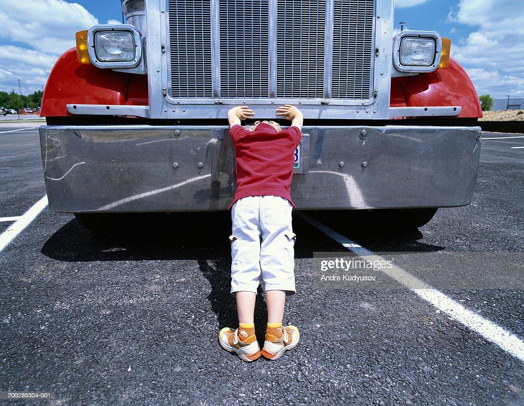 Boy Pushing Against Semi Truck Rear View Stock Photo - Getty