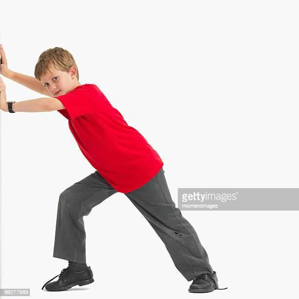 boy pushing something - pushing stock pictures, royalty-free photos & images