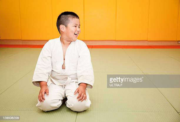 Boy puts on the uniform of judo