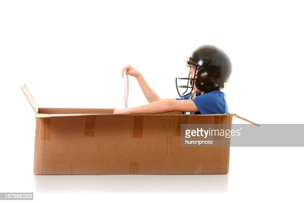 boy racing a box