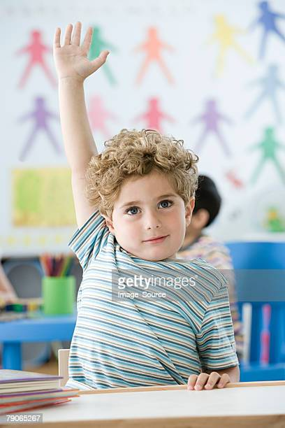 boy raising arm - asking stock pictures, royalty-free photos & images
