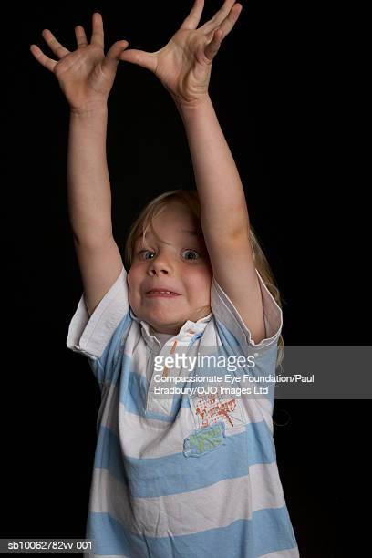 """boy (4-5) raising arms, portrait - """"compassionate eye"""" stock pictures, royalty-free photos & images"""