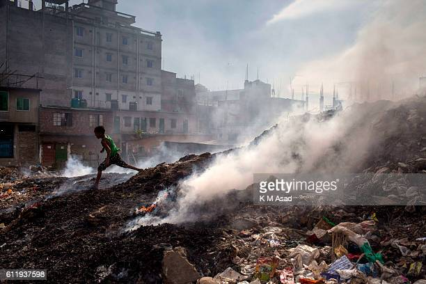 MOHAMMADPUR DHAKA BANGLADESH A boy ran beside in the waste burning dumps area producing smoke and toxic pollution at Mohammadpur According to the...