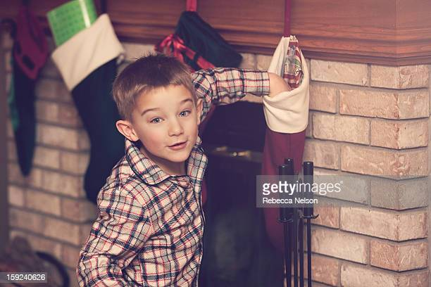 Boy Reaching into Christmas Stocking