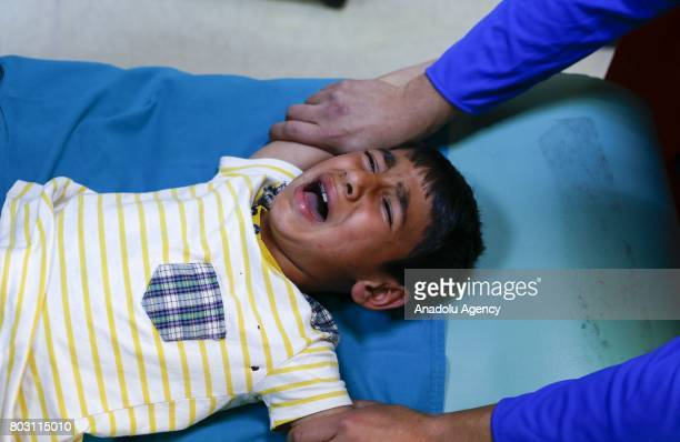 A boy reacts as paramedics perform a circumcision on him in Turkey's Ankara on June 25 2017 Circumcision a surgical ritual primarily based on...