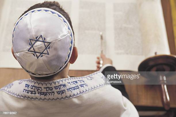 Boy reading the torah at his Bar Mitzvah