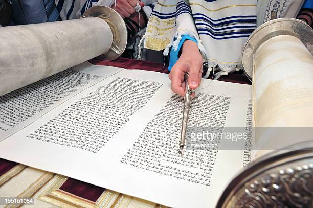 boy reading torah bar mitzvah - torah stock pictures, royalty-free photos & images