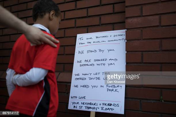 A boy reads a sign outside Finsbury Park Mosque on June 19 2017 in London England Worshippers were struck by a hired van as they were leaving...