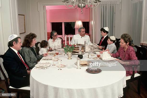 A boy reads from the Haggadah a service narrative during Seder The feast is celebrated on the first two days of Passover a holiday commemorating the...