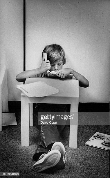 NOV 12 1975 NOV 15 1975 NOV 16 1975 Boy Reads Quietly On His Own IGE stresses individual selfdirected study