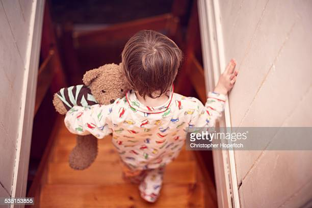 Boy ready for bed with his Teddy bear