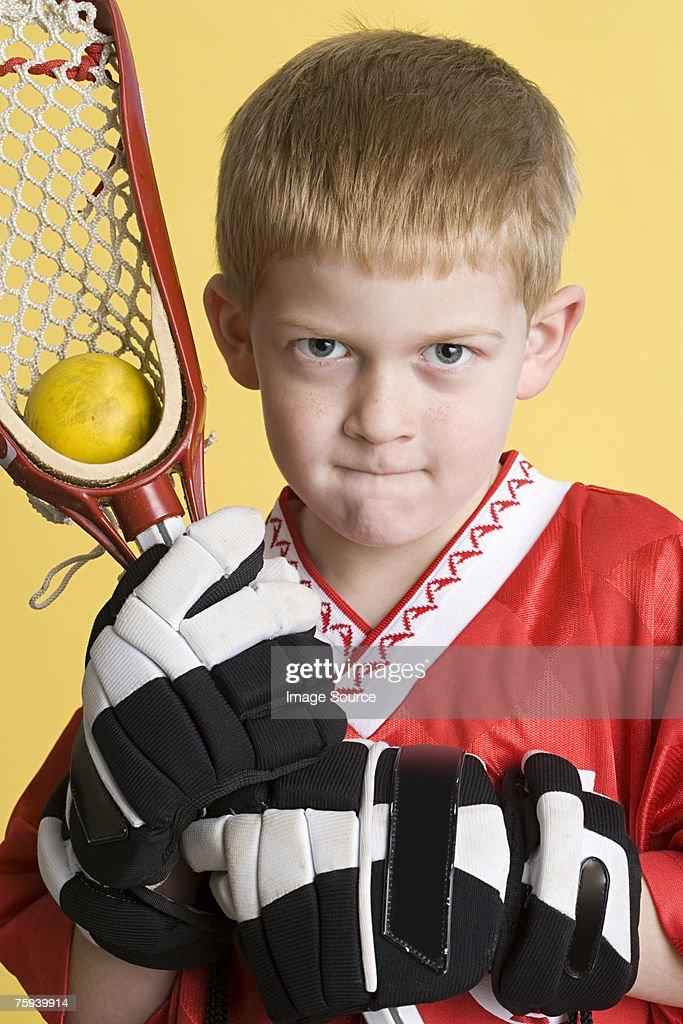 Boy ready for lacrosse : Stock Photo