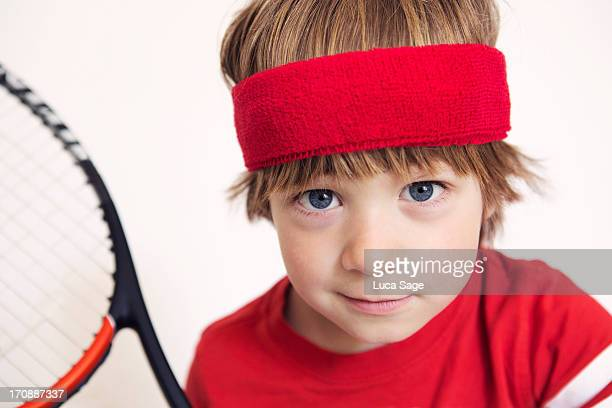 boy ready for tennis - headband stock pictures, royalty-free photos & images