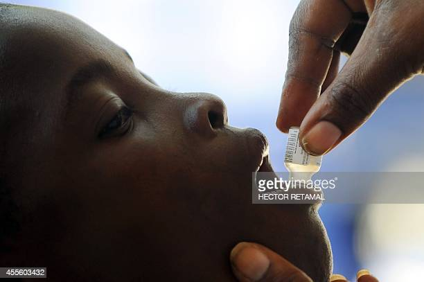 A boy receives the second dose of the vaccine against cholera in Saut d'Eau in the Central Plateau of Haiti on 17 September 2014 The UN has launched...