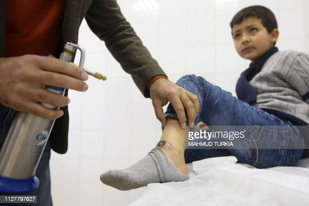 Boy receives treatment for Leishmaniasis at the Bir Al-Ostah Milad Hospital for Dermatology in the Libyan capital, Tripoli on February 11, 2019.