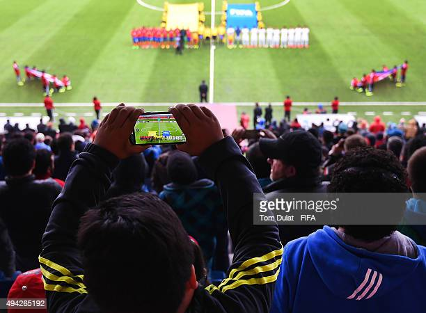 A boy records on a mobile phone teams line up during the FIFA U17 World Cup Chile 2015 Group E match between Costa Rica and Korea DPR at Estadio...