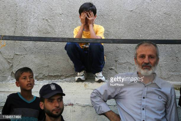 A boy relative of Hamas security member Salama alNadeem mourns during his funeral in Gaza City on 28 2019 The Gaza Strip was in a quotstate of...