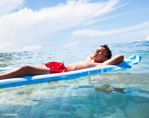 Boy Relaxing at the Sea
