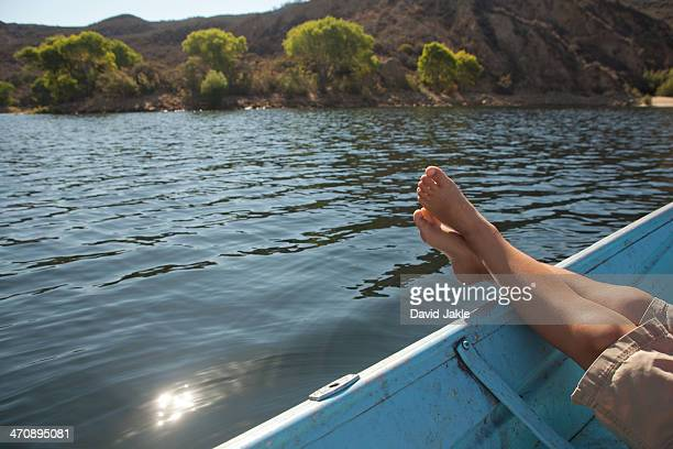 boy relaxing with feet up on boat - castaic lake stock pictures, royalty-free photos & images