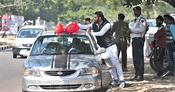 A boy removed the heart shape balloons after the police man stop him as he celebrated Valentine`s Day on February 14 2015 in Chandigarh India...