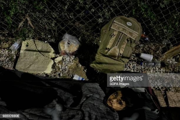 A boy rests on the gravel outside Moria Camp where asylumseekers and migrants are required to register with authorities after arriving in Greece In...