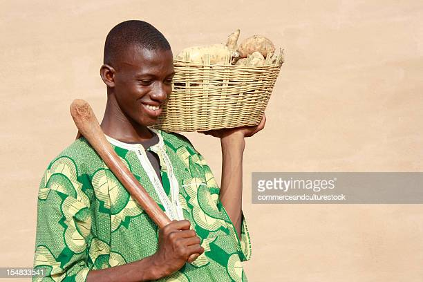 Boy returning from the market with yams