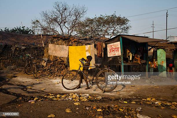 A boy returns home after working to scavenge coal from an opencast coal mine in the village of Guhanwadi on February 09 2012 near Jharia India...
