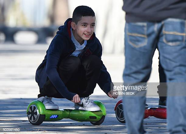 A boy rides a hoverboard the day after Christmas in San Pedro California December 26 2015 Reports of some hoverboards also known as selfbalancing...