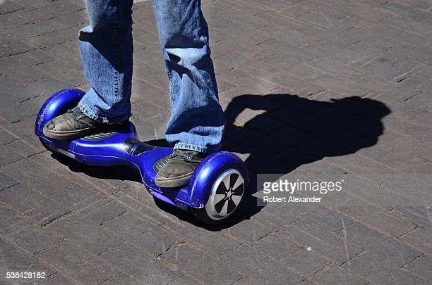 A boy rides his batteryoperated hoverboard in Santa Fe New Mexico on May 22 2016