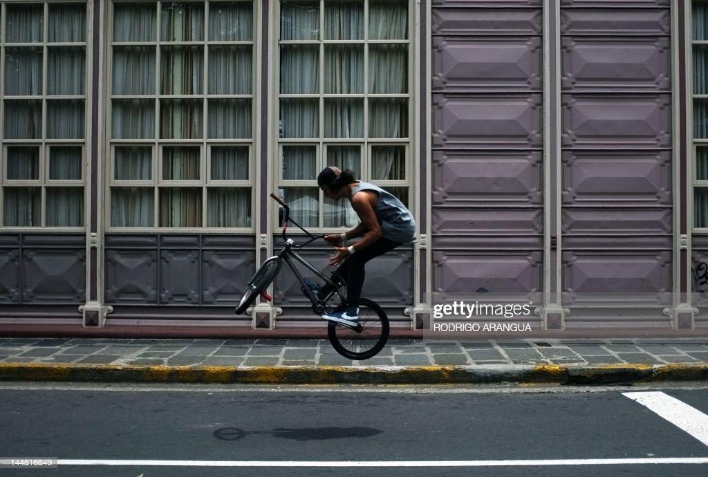 A boy rides his bike at Morazon square in San Jose, on May 19, 2012. The Costa Rican Ministry of Culture and Youth is launching cultural activities under the slogan 'Fall in love with your city', such as art workshops, music, theater, dance, and traditional games, that take place every Saturday in different parts of downtown San Jose. AFP PHOTO/Rodrigo ARANGUA /