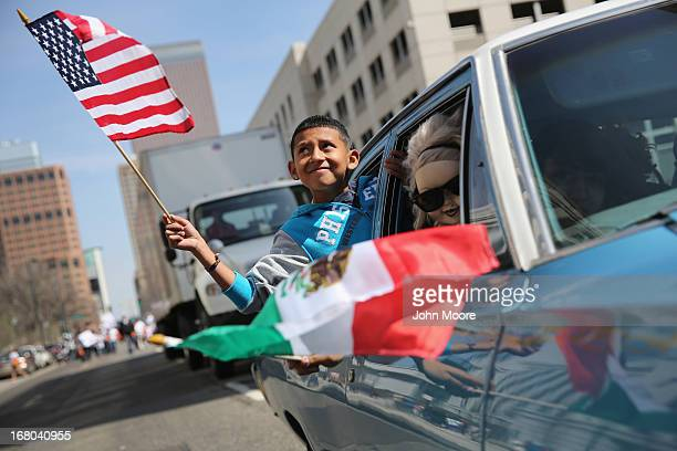 Boy rides in a low rider during a Cinco de Mayo parade on May 4, 2013 in Denver, Colorado. Hundreds of thousands of people were expected to attend...