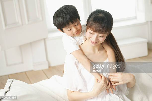 Boy rides on mother's back