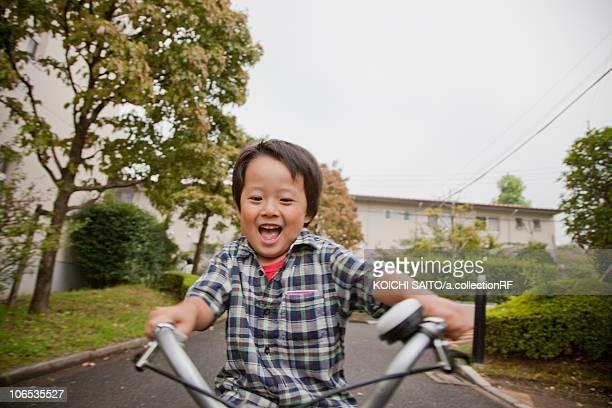 Boy riding a bicycle, Tokyo Prefecture, Honshu, Japan