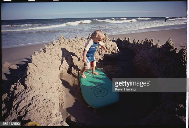 Boy Riding a Wakeboard in Sandcastle Moat