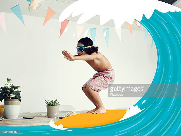 Boy riding a wave on surf board