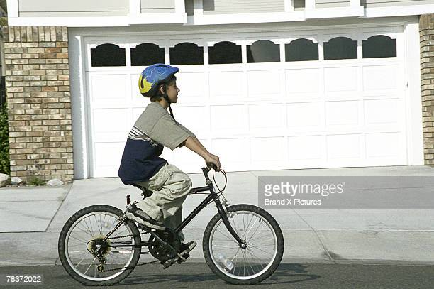 Boy riding bicycle with helmet