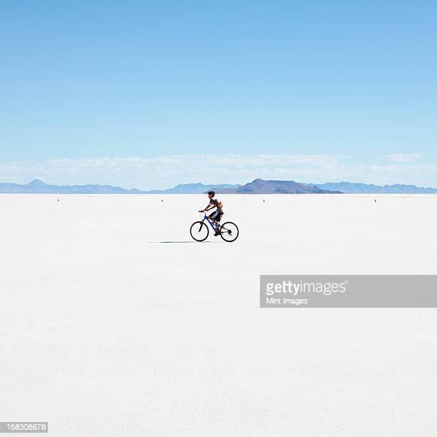 boy riding bike on salt flats, during speed week - bonneville salt flats stock pictures, royalty-free photos & images