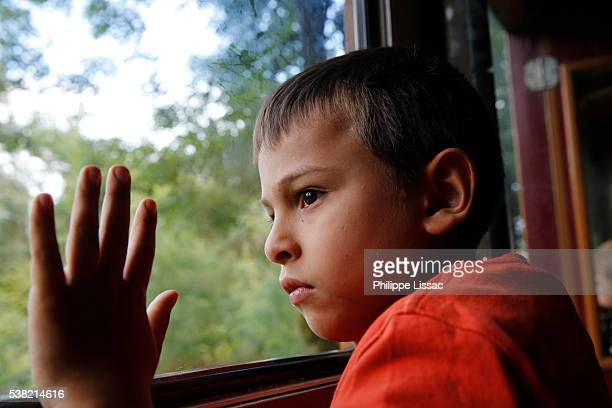 boy riding on a train - hauts de france stock photos and pictures
