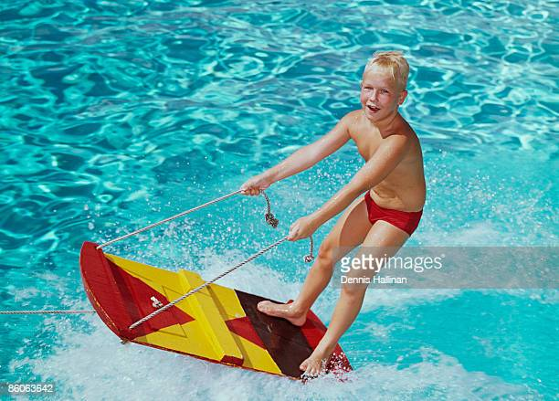 Boy Riding on a Water Sled