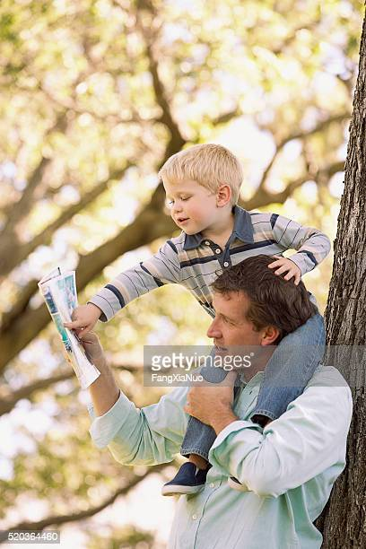 Boy riding on his father's shoulders