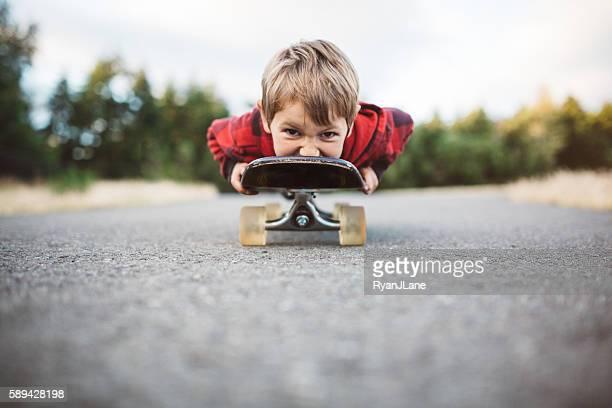 Boy Riding on Skateboard
