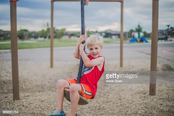 Boy Riding Playground Zip Line