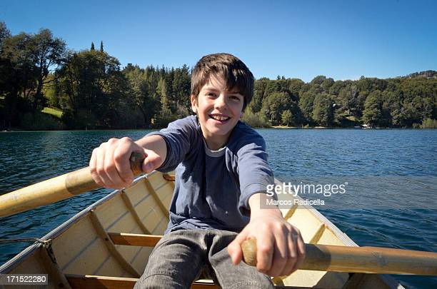 boy rowing on the lake - radicella imagens e fotografias de stock